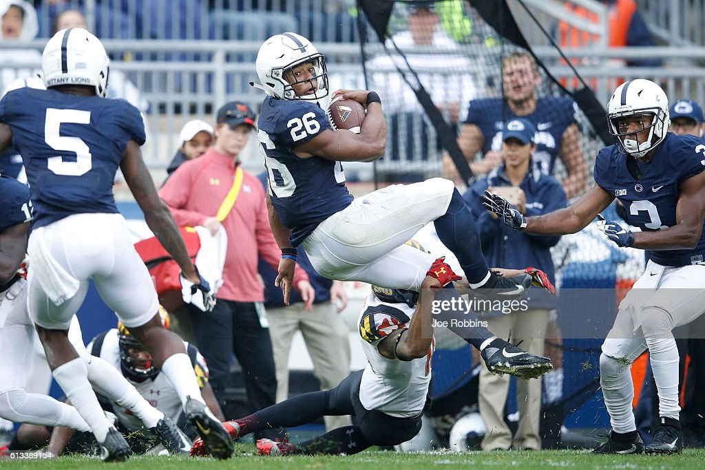 Saquon Barkley of the Penn State Nittany Lions runs with the ball against the Maryland Terrapins in the third quarter at Beaver Stadium on October 8...
