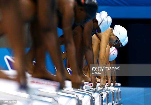 Sara Alflaij of Bahrain prepares to dive off the starting blocks in the Women's 50m Freestyle heat 2 on Day 7 of the London 2012 Olympic Games at the...