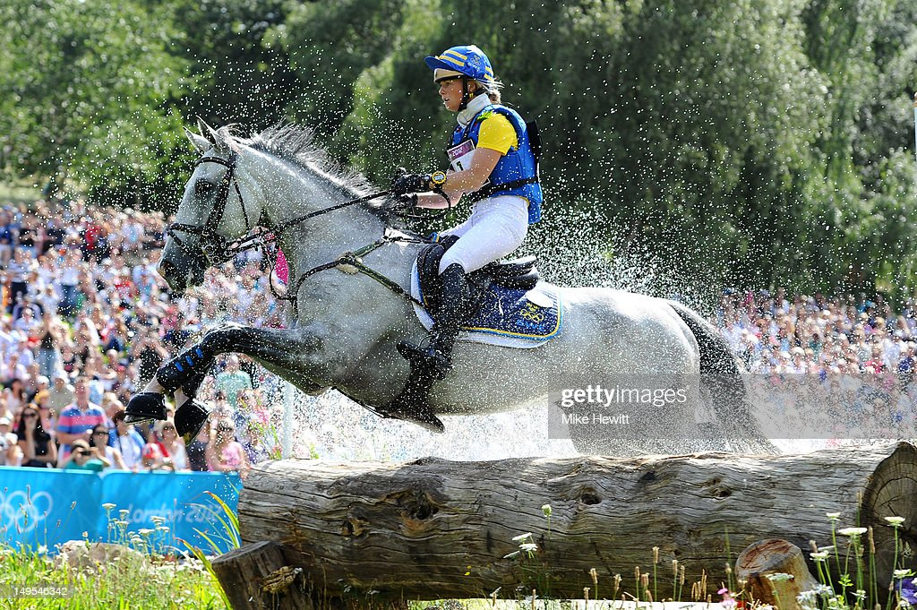 Sara Algotsson Ostholt of Sweden riding Wega negotiates a log jump in the Eventing Cross Country Equestrian event on Day 3 of the London 2012 Olympic Games at Greenwich Park on July 30, 2012 in London, England.