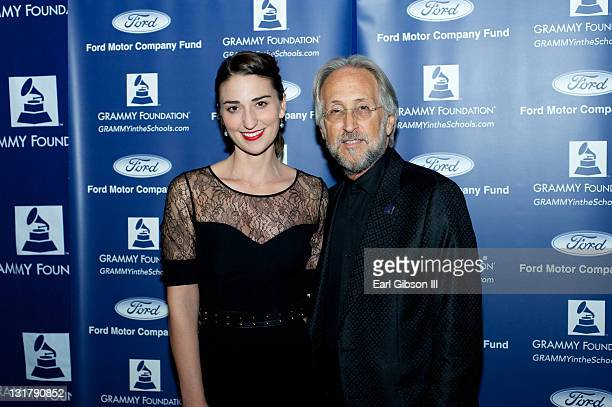 Sara Bareilles and Neil Portnow pose for a photo at GRAMMY In The Schools Live Grand Ballroom on February 9 2011 in Los Angeles California