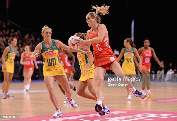 Sara Bayman of England gets past Gabrielle Simpson of Australia during the first match of the Vitality Netball International Series between England...