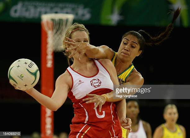 Sara Bayman of England under pressure from Mo'oina Gerrard of Australia during the 2012 Quad Series match between the Australian Diamonds and England...