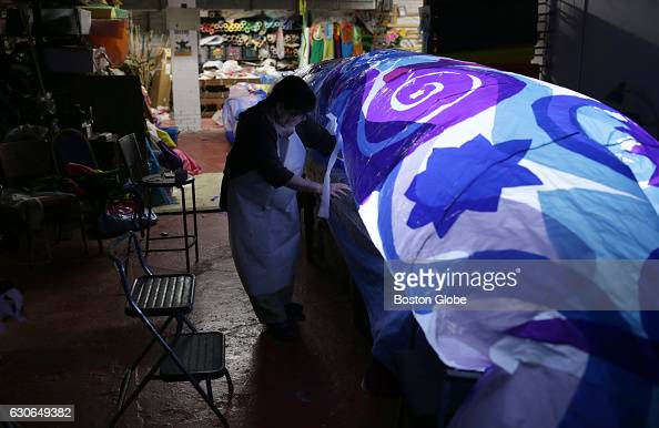 Sara Beattle test inflates a Dream Snake Puppet at her shop on Newbury Street in Boston on Dec 28 2016 This and other of her puppets will be in this...