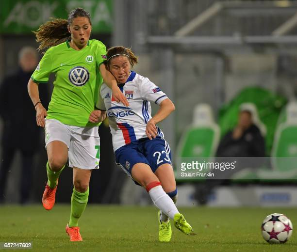 Sara Bjork Gunnarsdttir of Wolfsburg challenges Camille Abilyof Lyon during the UEFA Women's Champions League Quater Final first leg match between...