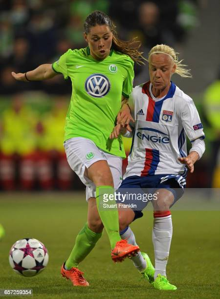Sara Bjork Gunnarsdttir of Wolfsburg is challenged by Caroline Seger of Lyon during the UEFA Women's Champions League Quater Final first leg match...