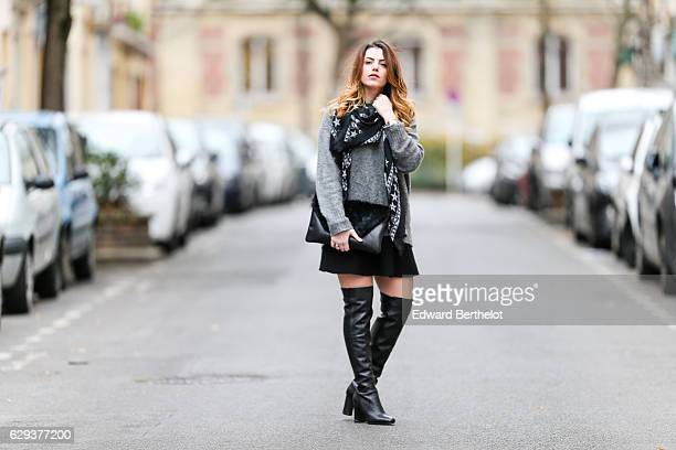 Sara Carnicella fashion and life style blogger is wearing Michael Kors black thigh high boots a Givenchy black scarf with white stars a Nicoletta...