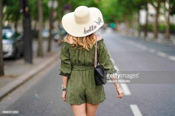 Sara Carnicella fashion blogger wears a Forever 21 hat a Zara green khaki off shoulder dress suit a Valentino bag and Valentino heels shoes on June...