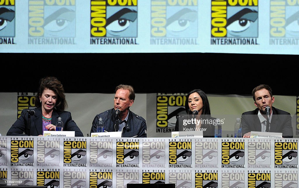 Sara Colleton, Scott Buck, <a gi-track='captionPersonalityLinkClicked' href=/galleries/search?phrase=Aimee+Garcia&family=editorial&specificpeople=561569 ng-click='$event.stopPropagation()'>Aimee Garcia</a>, and <a gi-track='captionPersonalityLinkClicked' href=/galleries/search?phrase=Desmond+Harrington&family=editorial&specificpeople=2301149 ng-click='$event.stopPropagation()'>Desmond Harrington</a> speak onstage at the 'Trailer Park' panel during Comic-Con International 2013 at San Diego Convention Center on July 18, 2013 in San Diego, California.