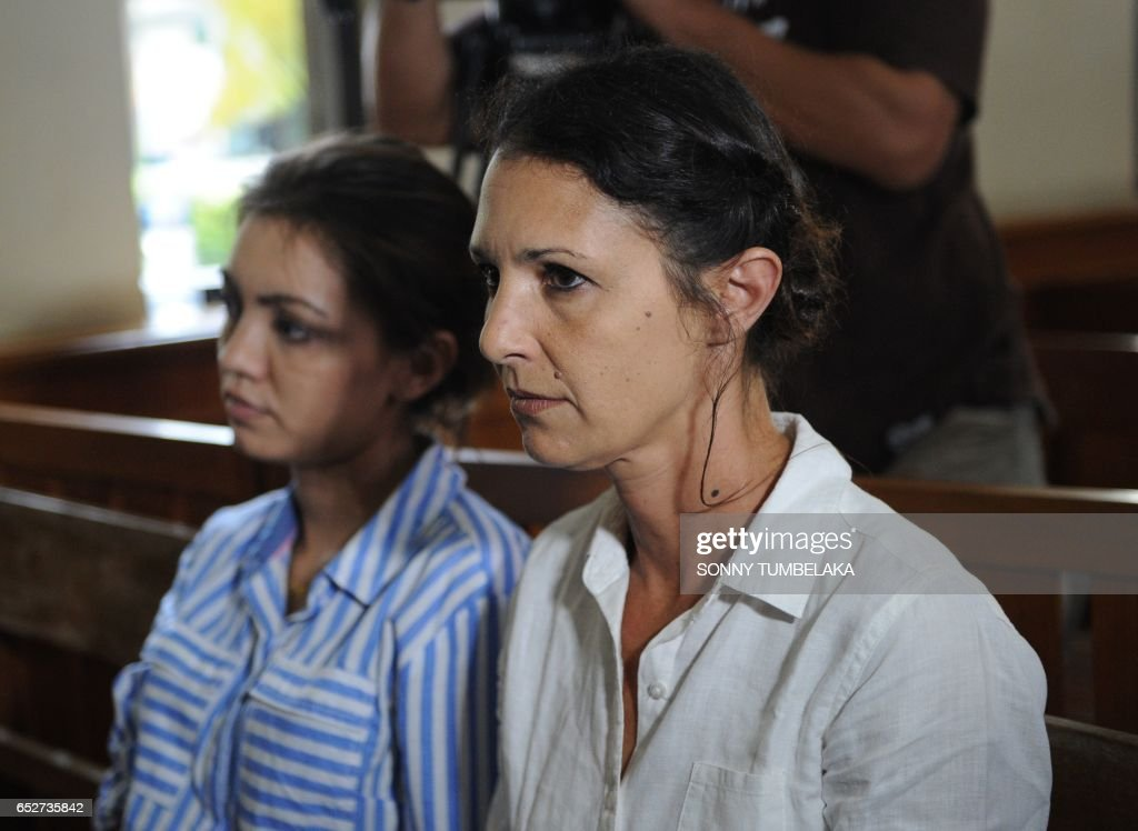 Sara Connor of Australia (R) attends her trial at a court in Denpasar on Indonesia's resort island of Bali on March 13, 2017. David Taylor was found guilty at a court on the island of fatal group assault over the killing of officer Wayan Sudarsa, whose battered body was found in August last year. The court was due to hand down its verdict for his Australian girlfriend Sara Connor, 46, on March 13. /