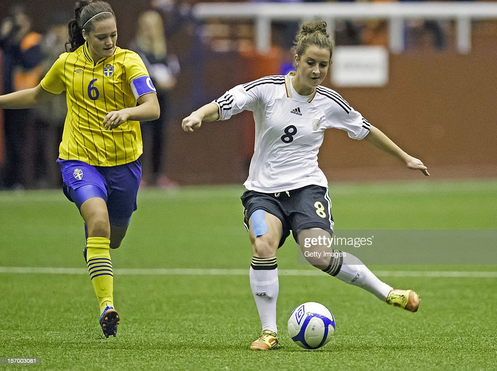 Sara Dabritz of Germany with the ball (in the background Julia Wahlberg of Sweden), during the Under 19 Women's international friendly between Sweden and Germany at Tipshallen Stadium on November 21, 2012 in Vaxjo, Sweden.