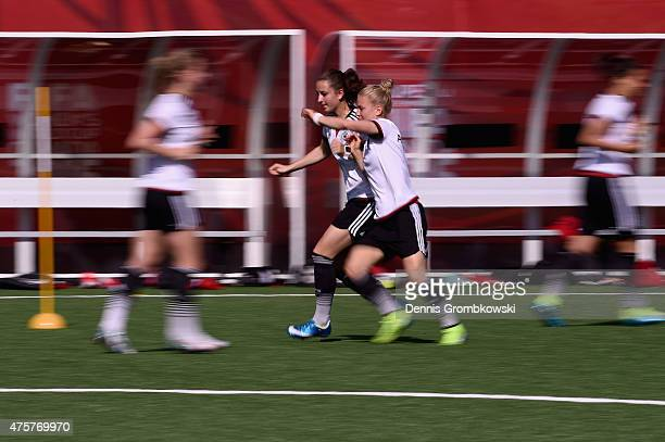 Sara Daebritz and Leonie Maier of Germany practice during an afternoon training session at Algonquin College Soccer Complex on June 3 2015 in Ottawa...