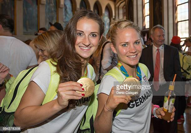 Sara Daebritz and Leonie Maier pose with their gold medals on August 23 2016 in Frankfurt am MaIN GERMANY