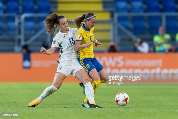 Sara Daebritz of Germany and Kosovare Asllani of Sweden battle for the ball l during the Group B match between Germany and Sweden during the UEFA...