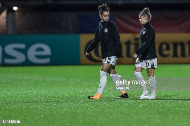 Sara Daebritz of Germany and Linda Dallmann leave the pitch after the game was postponed due to heavy rain prior to the UEFA Women's Euro 2017...