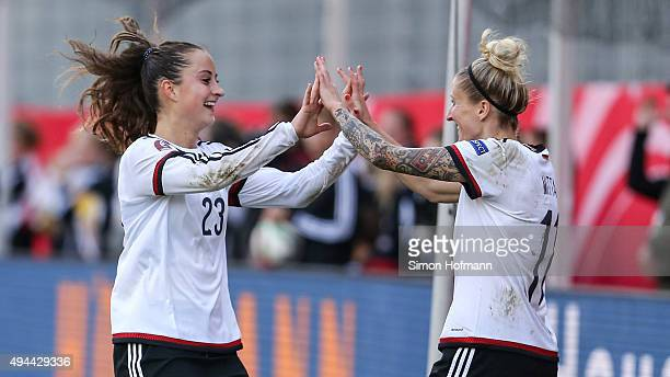 Sara Daebritz of Germany celebrates her team's seventh goal with team mate Anja Mittag during the UEFA Women's Euro 2017 Qualifier match between...