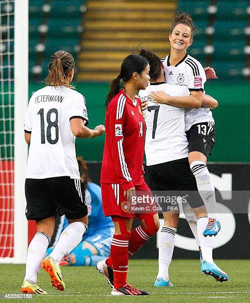 Sara Daebritz of Germany celebrates scoring a penalty kick against goalkeeper Lu Feifei of China PR at Commonwealth Stadium on August 8 2014 in...