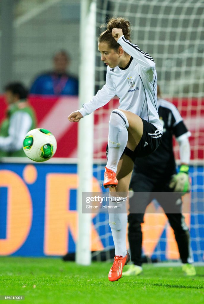 Sara Daebritz of Germany controls the ball during a Germany training session at Volksbank Stadion on October 29, 2013 in Frankfurt am Main, Germany.