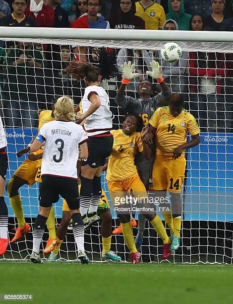 Sara Daebritz of Germany heads the ball past Lindiwe Magwede of Zimbabwe to score during the Women's First Round Group F match between Zimbabwe and...