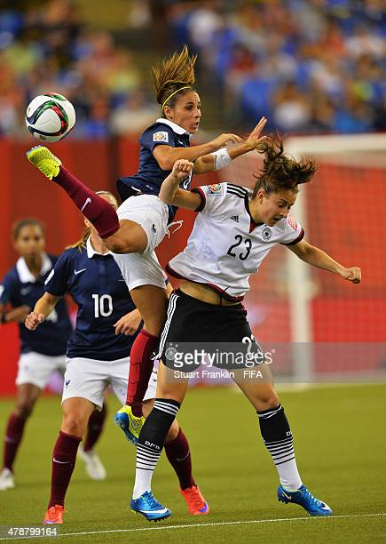 Sara Daebritz of Germany is challenged by Jessica Houra of France during the quarter final match of the FIFA Women's World Cup between Germany and...