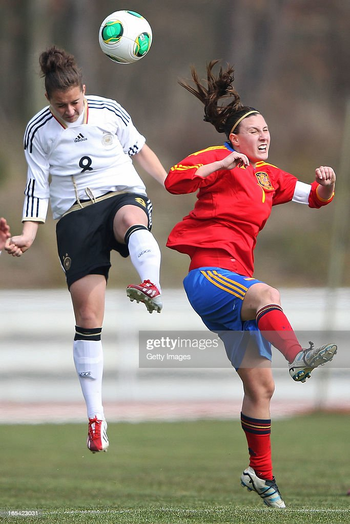 Sara Daebritz of Germany jumps for a header with Gema Gili Giner of Spain during the Women's UEFA U19 Euro Qualification match between U19 Germany and U19 Spain at Waldstadion in Viernheim on April 4, 2013 in Viernheim, Germany.
