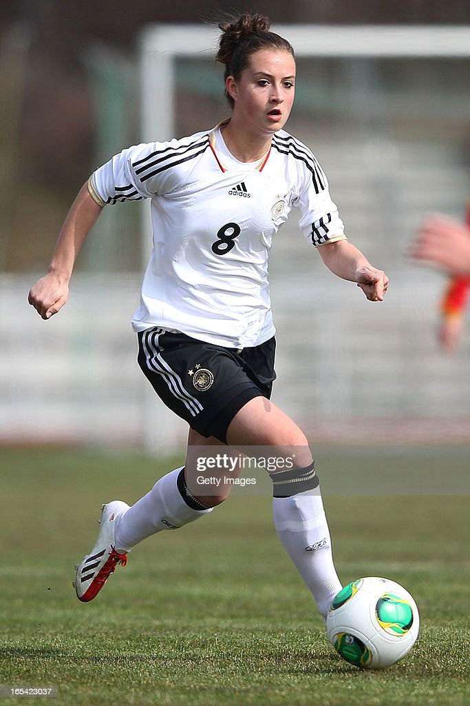 Sara Daebritz of Germany runs with the ball during the Women's UEFA U19 Euro Qualification match between U19 Germany and U19 Spain at Waldstadion in Viernheim on April 4, 2013 in Viernheim, Germany.