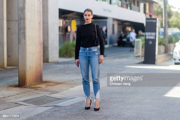 Sara Donaldson wearing a black knit blue denim jeans heels at day 4 during MercedesBenz Fashion Week Resort 18 Collections at Carriageworks on May 17...