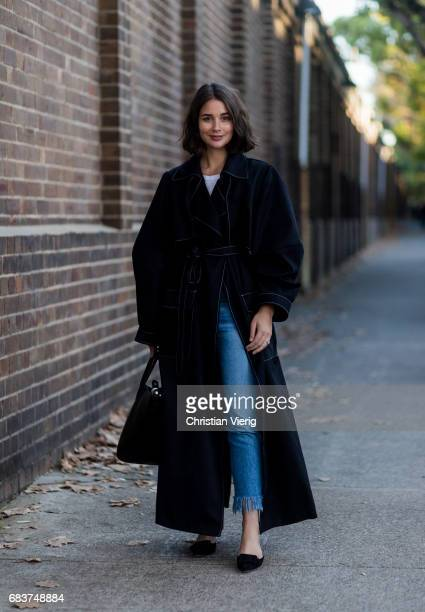 Sara Donaldson wearing cropped denim jeans black coat at day 3 during MercedesBenz Fashion Week Resort 18 Collections at Carriageworks on May 16 2017...