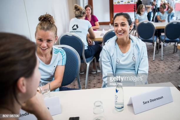 Sara Doorsoun and Linda Dallmann smile during a interview at Germany Women's National Soccer Team Media Day on July 5 2017 in Heidelberg Germany