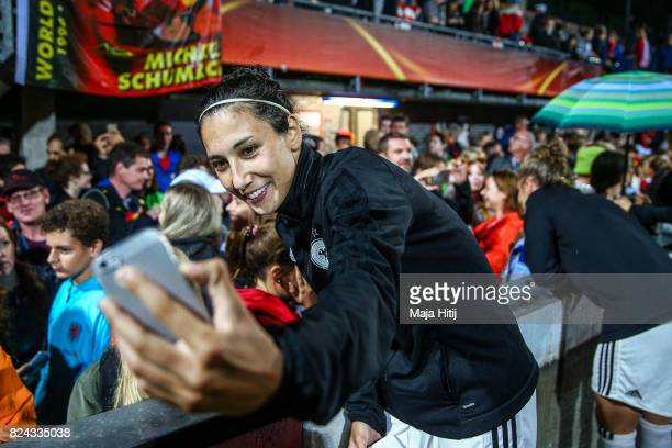 Sara Doorsoun of Germany poses with the fans after the game was postponed due to heavy rain prior to the UEFA Women's Euro 2017 Quarter Final match...