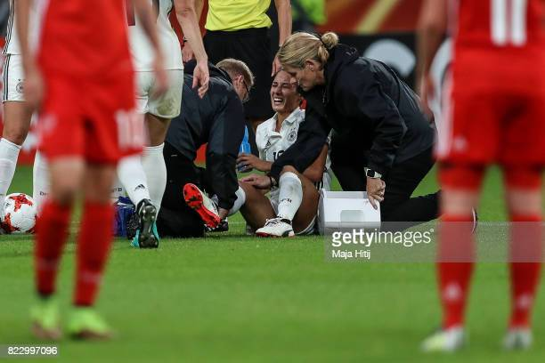 Sara Doorsoun of Germany receives treatment from the medical team during the Group B match between Russia and Germany during the UEFA Women's Euro...