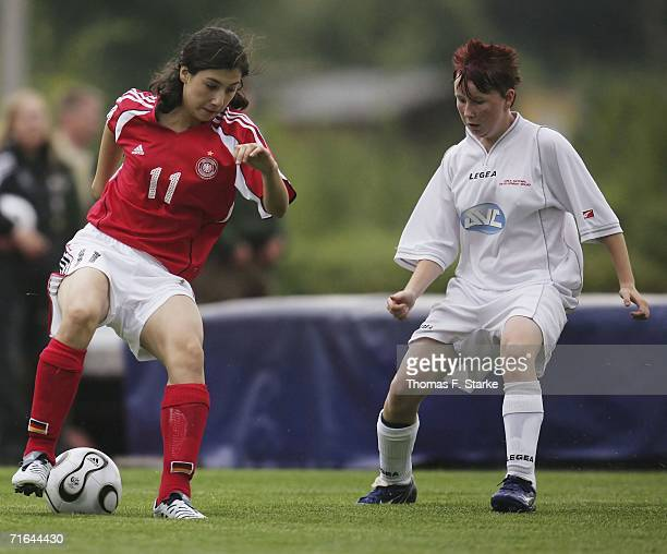 Sara Doorsoun of Germany tackles for the ball with Stacey John of Wales during the Women's Under 15 match between Germany and Wales on August 14 2006...