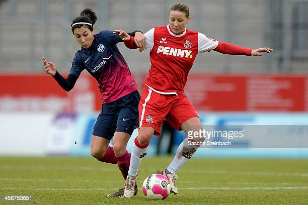 Sara DoorsounKhajeh of Essen and Inka Grings of Koeln battle for the ball during the Women's DFB Cup match between SGS Essen and 1 FC Koeln at...