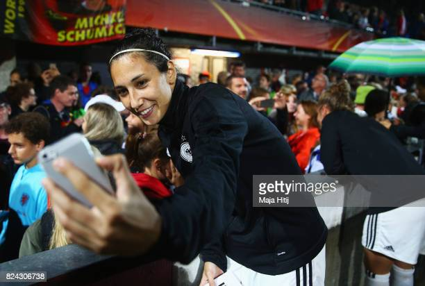 Sara DoorsounKhajeh of Germany takes a selfie with fans after the game was postponed due to heavy rain prior to the UEFA Women's Euro 2017 Quarter...