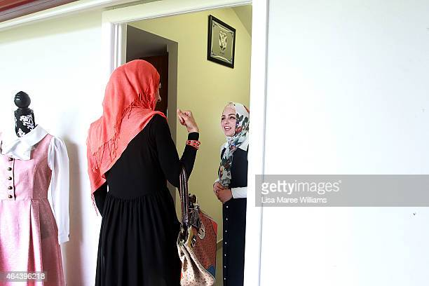 Sara Elmir greets Emna Zahab at her home clothing studio on December 4 2014 in Bankstown Australia Sara Elmir 26 and mother of two is a leading...