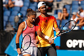 Sara Errani and Fabio Fognini of Italy during their first round mixed doubles match against Arantxa Parra Santonja and Marc Lopez of Spain during day...