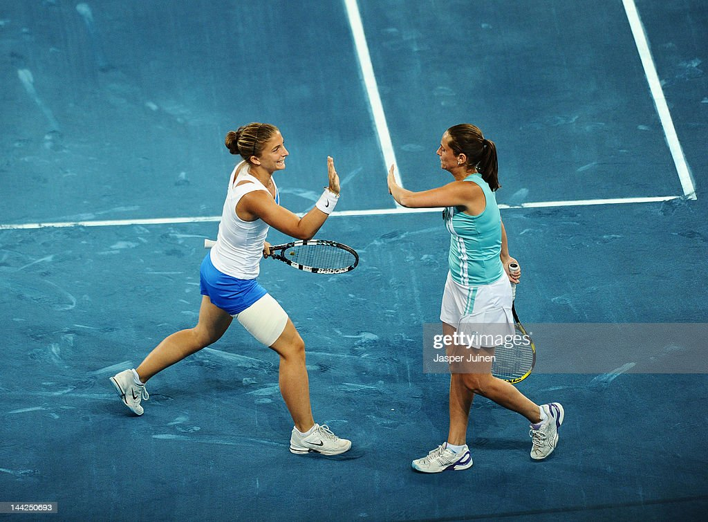 Sara Errani and Roberta Vinci of Italy celebrate matchpoint over Ekaterina Makarova and Elena Vesnina of Russia in their semi final match during the Mutua Madrilena Madrid Open tennis tournament at the Caja Magica on May 12, 2012 in Madrid, Spain.