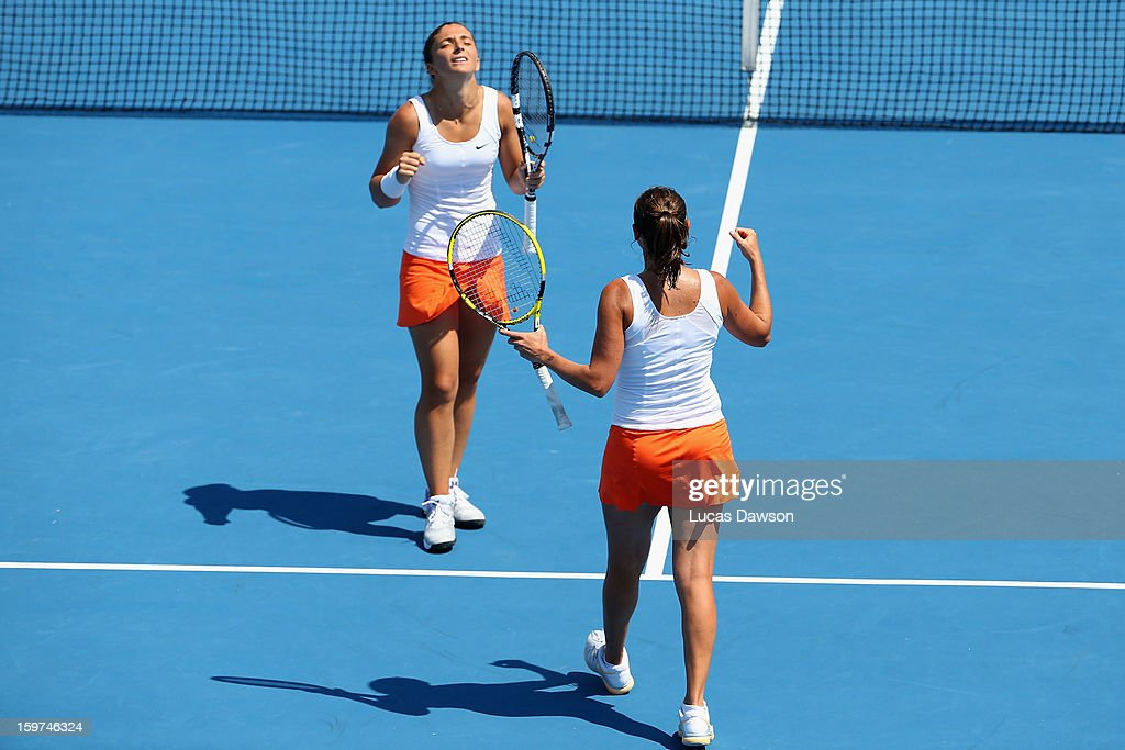 Sara Errani and Roberta Vinci of Italy celebrate winning their third round doubles match against Su-Wei Hsieh of Chinese Taipei and Shuai Peng of China during day seven of the 2013 Australian Open at Melbourne Park on January 20, 2013 in Melbourne, Australia.