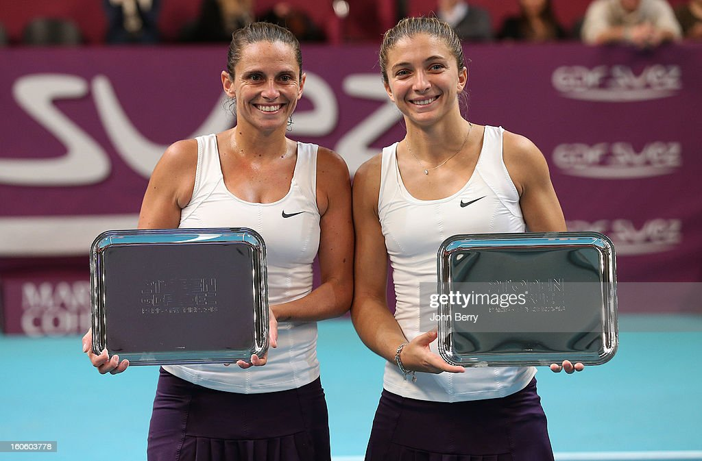 Sara Errani and Roberta Vinci of Italy hold the trophy after winning the doubles final of the Open GDG Suez 2013 at the Stade Pierre de Coubertin on February 3, 2013 in Paris, France.