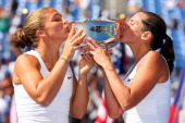 Sara Errani and Roberta Vinci of Italy kiss the trophy following their victory against Andrea Hlavackova and Lucie Hradecka of the Czech Republic in...