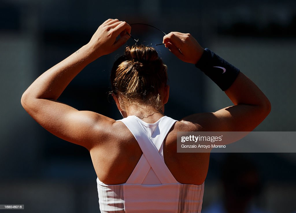 Sara Errani of Italy adjusts her hairband during her semi-final match against Serena Williams of the US on day eight of the Mutua Madrid Open tennis tournament at the Caja Magica on May 11, 2013 in Madrid, Spain.