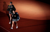 Sara Errani of Italy and Maria Sharapova of Russia before their semi final match on day six of the Porsche Tennis Grand Prix at Porsche Arena on...