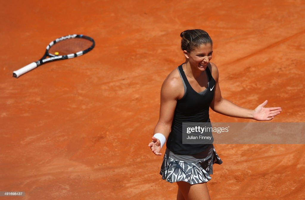 <a gi-track='captionPersonalityLinkClicked' href=/galleries/search?phrase=Sara+Errani&family=editorial&specificpeople=599213 ng-click='$event.stopPropagation()'>Sara Errani</a> of Italy celebrates defeating Jelena Jankovic of Serbia during day seven of the Internazionali BNL d'Italia tennis 2014 on May 17, 2014 in Rome, Italy.