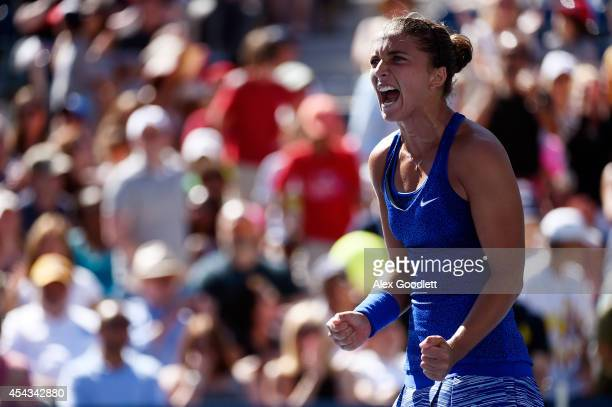 Sara Errani of Italy celebrates defeating Venus Williams of the United States during their women's singles third round match on Day Five of the 2014...