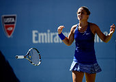 Sara Errani of Italy celebrates match point after defeating Venus Williams of the United States in their women's singles third round match on Day...