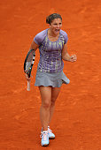 Sara Errani of Italy celebrates match point in her Women's Singles match against Sabine Lisicki of Germany during day six of the French Open at...