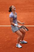 Sara Errani of Italy celebrates match point in her Women's Singles match against Carla Suarez Navarro of Spain during day eight of the French Open at...