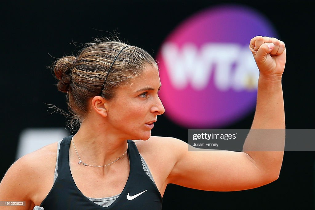 <a gi-track='captionPersonalityLinkClicked' href=/galleries/search?phrase=Sara+Errani&family=editorial&specificpeople=599213 ng-click='$event.stopPropagation()'>Sara Errani</a> of Italy celebrates winning the first set in her match against Li Na of China during day six of the Internazionali BNL d'Italia tennis 2014 on May 16, 2014 in Rome, Italy.