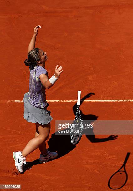 Sara Errani of Italy drops her racquet as she celebrates match point during her Women's Singles quarterfinal match against Agnieszka Radwanska of...