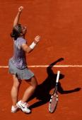 Sara Errani of Italy drops her racquet as she celebrates match point during her Women's Singles quarterfinal match against Agnieszka Radwanska of...