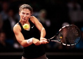 Sara Errani of Italy hits a forehand during her semi final match against Maria Sharapova of Russia on day six of the Porsche Tennis Grand Prix at...